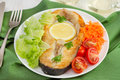 Fish with lemon, lettuce, tomato Royalty Free Stock Photos