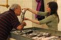 Fish market. buyer checking freshness .Split. Croatia Royalty Free Stock Photo