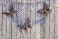 Fish net and butterflies on wooden fence decorated with fishnet Royalty Free Stock Photos