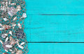 Fish netting with shells border on teal blue wood sign Royalty Free Stock Photo
