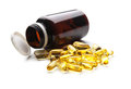 Fish oil capsule and container Royalty Free Stock Photo