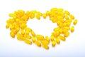 Fish oil capsules  yellow heart shaped Royalty Free Stock Photo