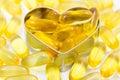 Fish oil pills on heart shape box Royalty Free Stock Photo