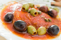 Fish with olives in tomato sauce. Stock Images