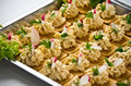 Fish pasta tarts with radish chopped salad appetizers and sliced radishes on a metal tray Stock Photo