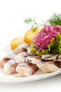 Fish with potato salted roasted and pickled onions Stock Images