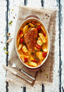 Fish and potatoes stewed in clay pot Royalty Free Stock Photo