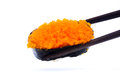Fish roe sishi with chopsticks sushi isolated on the white background Stock Image