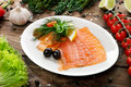 Fish - salted salmon sliced on a plate Royalty Free Stock Photo
