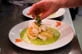 Fish and seafood with parsley sauce Stock Image