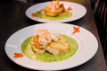 Fish and seafood with parsley sauce Royalty Free Stock Photos