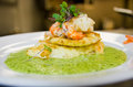 Fish and seafood with parsley sauce Stock Photos