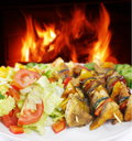 Fish shashlik with vegetable on fire background Stock Image
