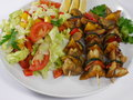 Fish shashlik with vegetable on plate Stock Photo