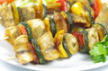 Fish shashlik with vegetable on plate Stock Image