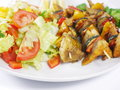 Fish shashlik with vegetable on white plate Royalty Free Stock Photography