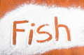Fish sign flour artwor with artwork with food and handprints fun background with human handpints in scattered on a wooden tabletop Stock Image