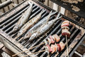 Fish and skewers on grill Royalty Free Stock Photo
