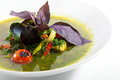 Fish soup minestrone with spinach over white Stock Images