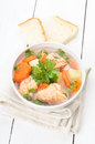 Fish soup on white wooden table Royalty Free Stock Photo