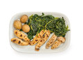 Fish spawn grilled with potatoes and greens Stock Photography