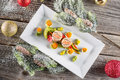 Fish starter food on white plate with christmas decoration. product photography and modern gastronomy Royalty Free Stock Photo