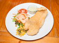 Fish steak with salad on table Royalty Free Stock Photos