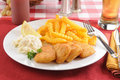 Fish sticks and french fries battered fillets with coleslaw beer Stock Photo