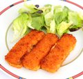 Fish sticks with salad some fresh Royalty Free Stock Photo