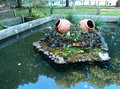 Fish tank and fountain in a garden italy Stock Image