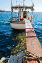 Fisher boat in porec croatia with a gangplank Royalty Free Stock Photos