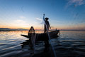 Fisherman in action, Silhouette portrait Royalty Free Stock Photo