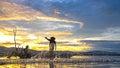 Fisherman of Bangpra Lake in action when fishing in the sunshine morning Royalty Free Stock Photo