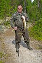 Fisherman with a big fish middle aged male the zander in karelia north russia Stock Photography