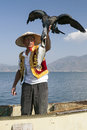 Fisherman with Bird and Fish Royalty Free Stock Photo
