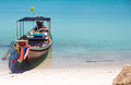 Fisherman boat on the beach white sand Stock Photos