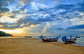Fisherman boats on andaman sea in sunset with dramatic clouds thailand Royalty Free Stock Photography
