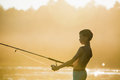 Fisherman boy with spinning Royalty Free Stock Photo