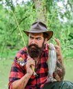 Fisherman on camping. Successful fishing. summer weekend. experienced fisher in forest. sport activity and hobby. man Royalty Free Stock Photo