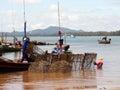 Fisherman carrys net in his boat