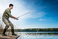 Fisherman catching fish angling at the lake Royalty Free Stock Photo