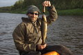 Fisherman caught a nice brown trout. Royalty Free Stock Photo