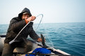Fisherman caught a salmon trolling in the early morning Royalty Free Stock Photo