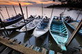 Fisherman docks floating on water at sunset image of boats during Stock Images