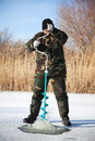 Fisherman drill on winter lake Stock Image