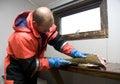 Fisherman filleting cod Royalty Free Stock Photo