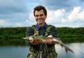 Fisherman with fish siberian stargeon fishing on river Stock Photo