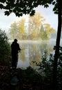 Fisherman fishing on lakeside