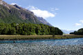 Fisherman fly fishing in fiordland nz jan eglinton river on jan nz has a world renowned wild trout fishery and area Royalty Free Stock Photography