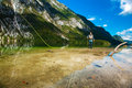 Fisherman fly fishing at lake Bohinj Royalty Free Stock Photos